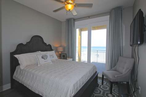 Bedroom #1 with queen bed (private bathroom, deck access and water view)