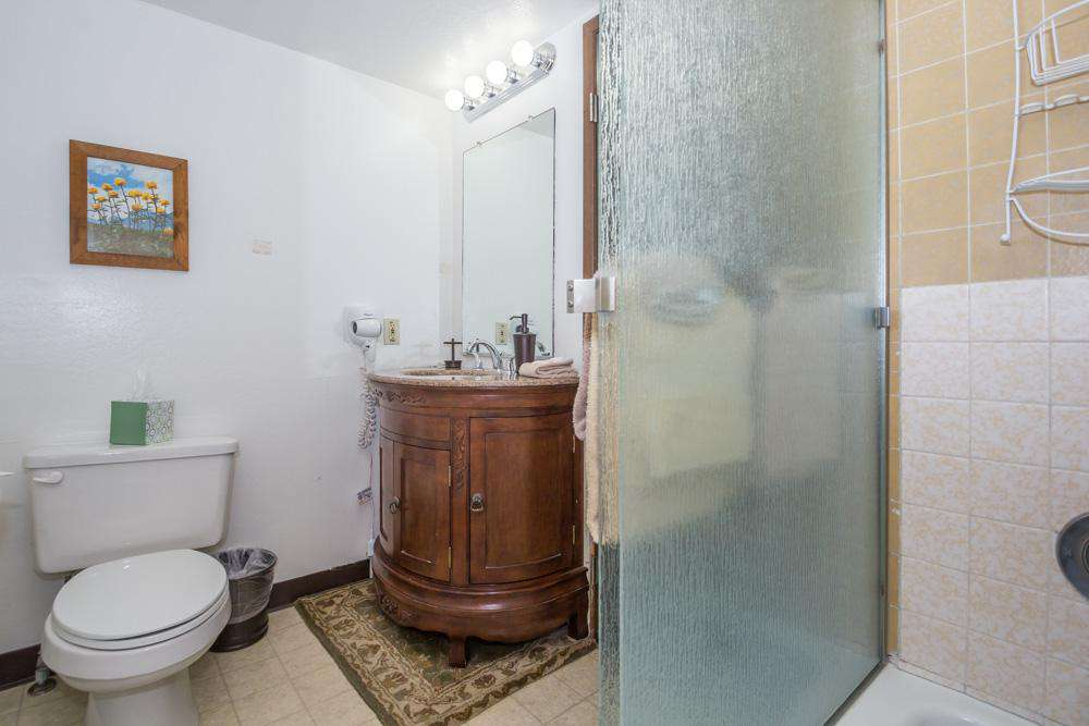 Upstairs bathroom with shower tub.