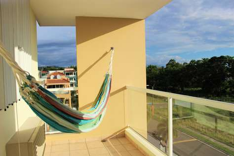 Balcony with hammock overlooking the beach