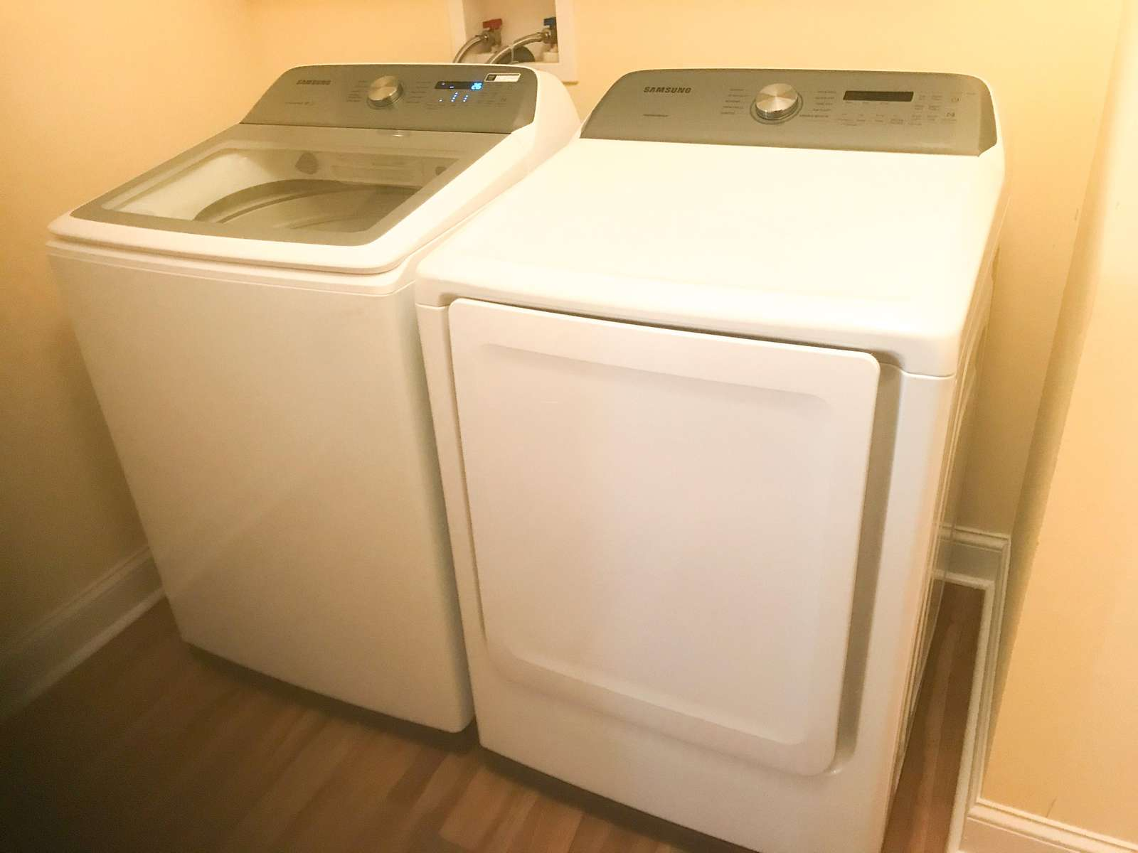 Full-size washer and dryer in laundry room