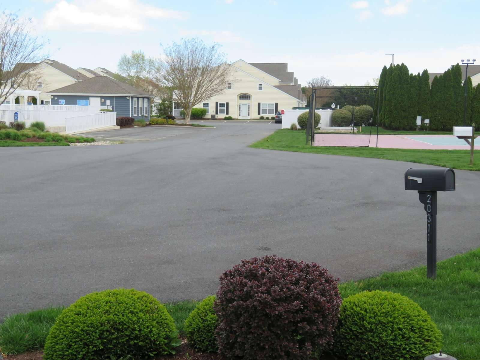 View from the front door (pool on right and tennis courts on left)