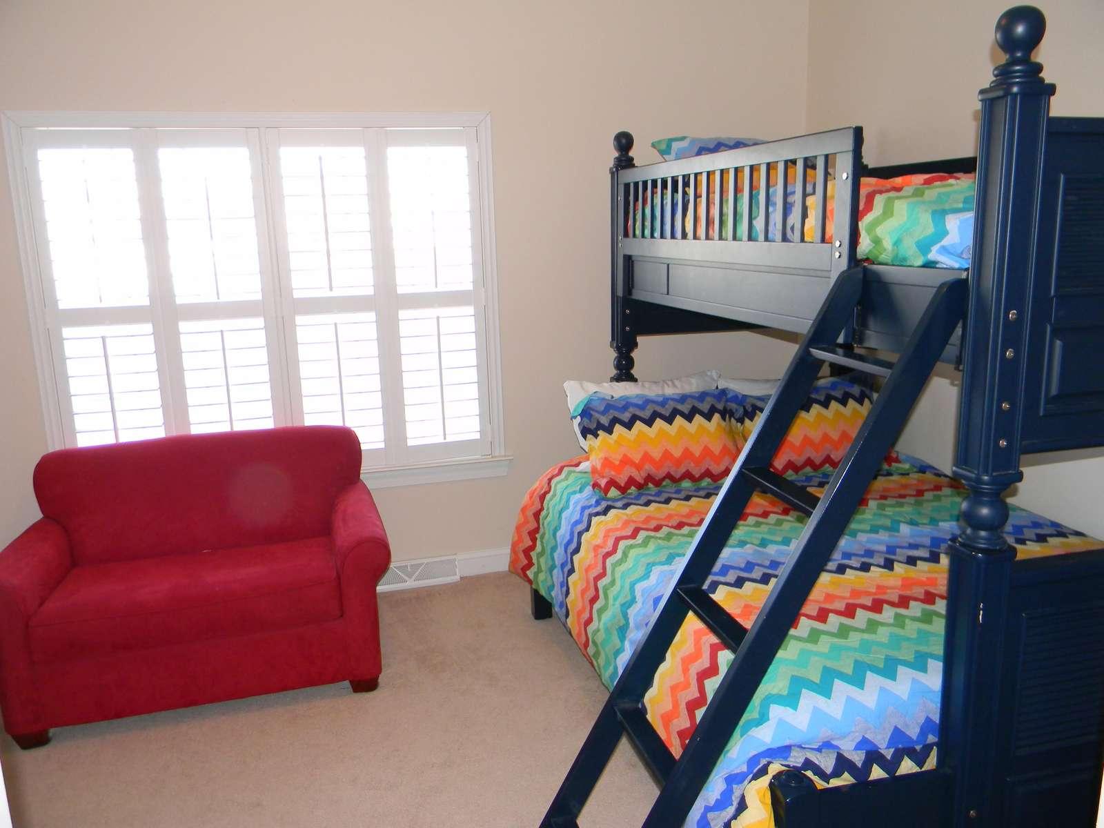 Bunk room with twin sleeper sofa