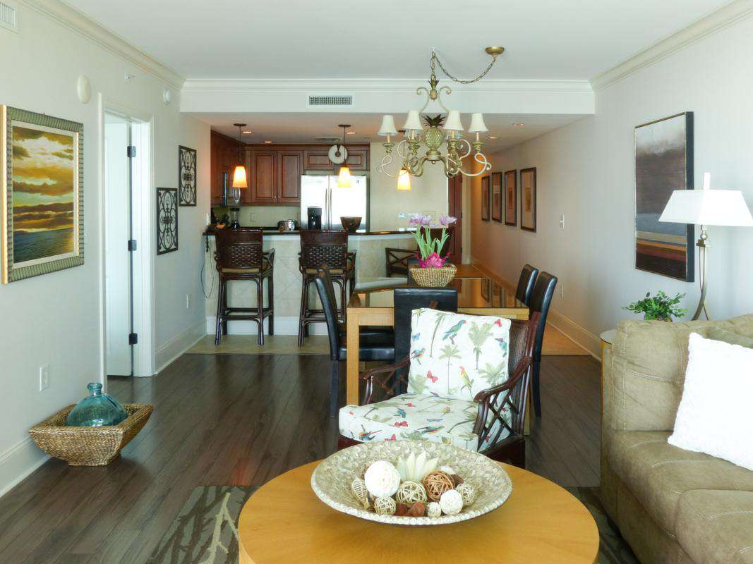 Custom laminate wood flooring throughout.
