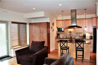 Kitchen perfect for entertaining, to the left is a double Murphy bed thumb