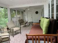 Comfortable screened porch with day bed. thumb