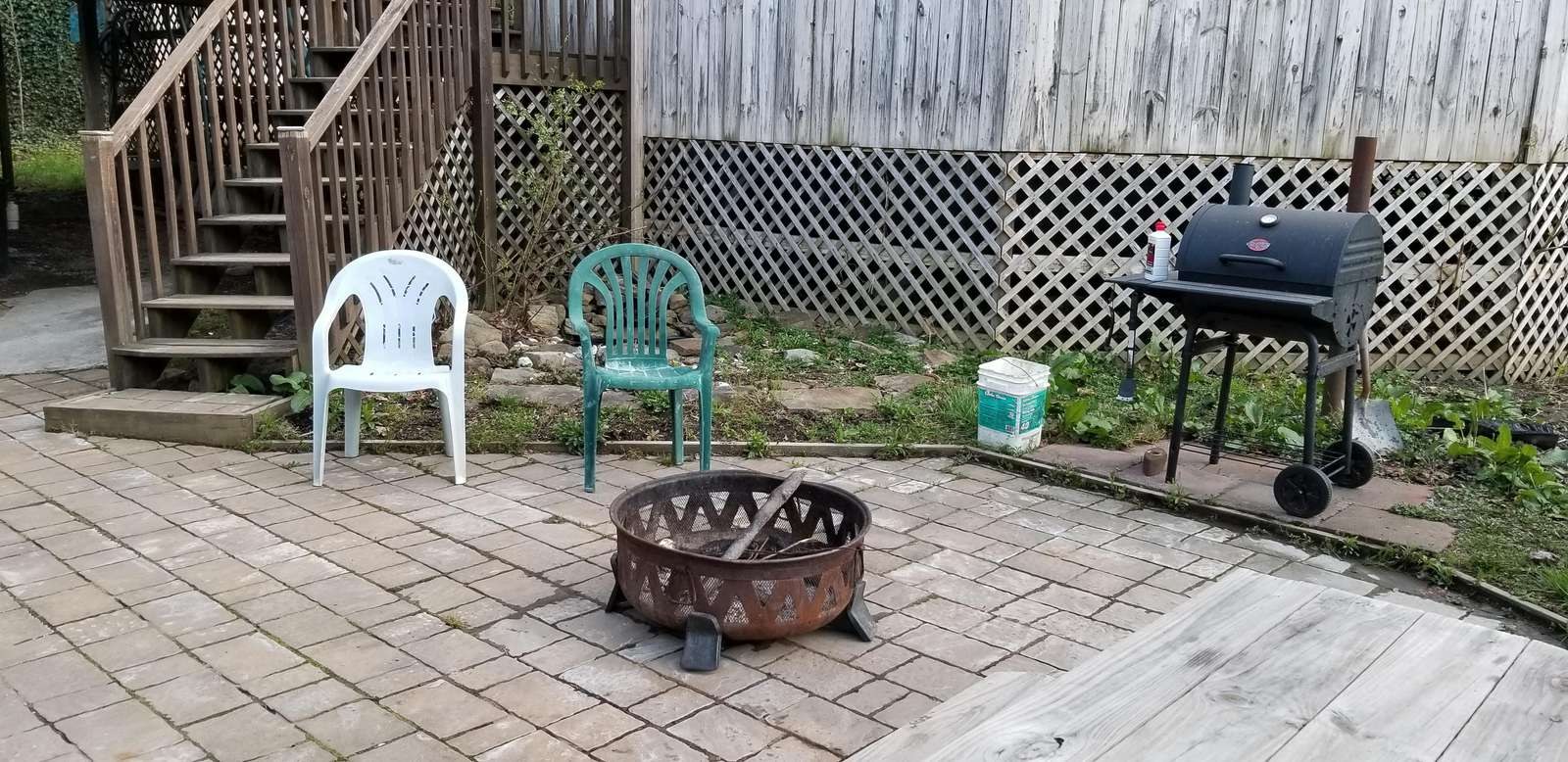 Large patio firepit, grill, tables chairs.