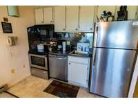 Fully-equipped kitchen with stainless steel appliance, pots, pans, utensils! thumb