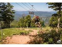 Enjoy Snowshoe's extensive trail system for downhill mountain biking! thumb