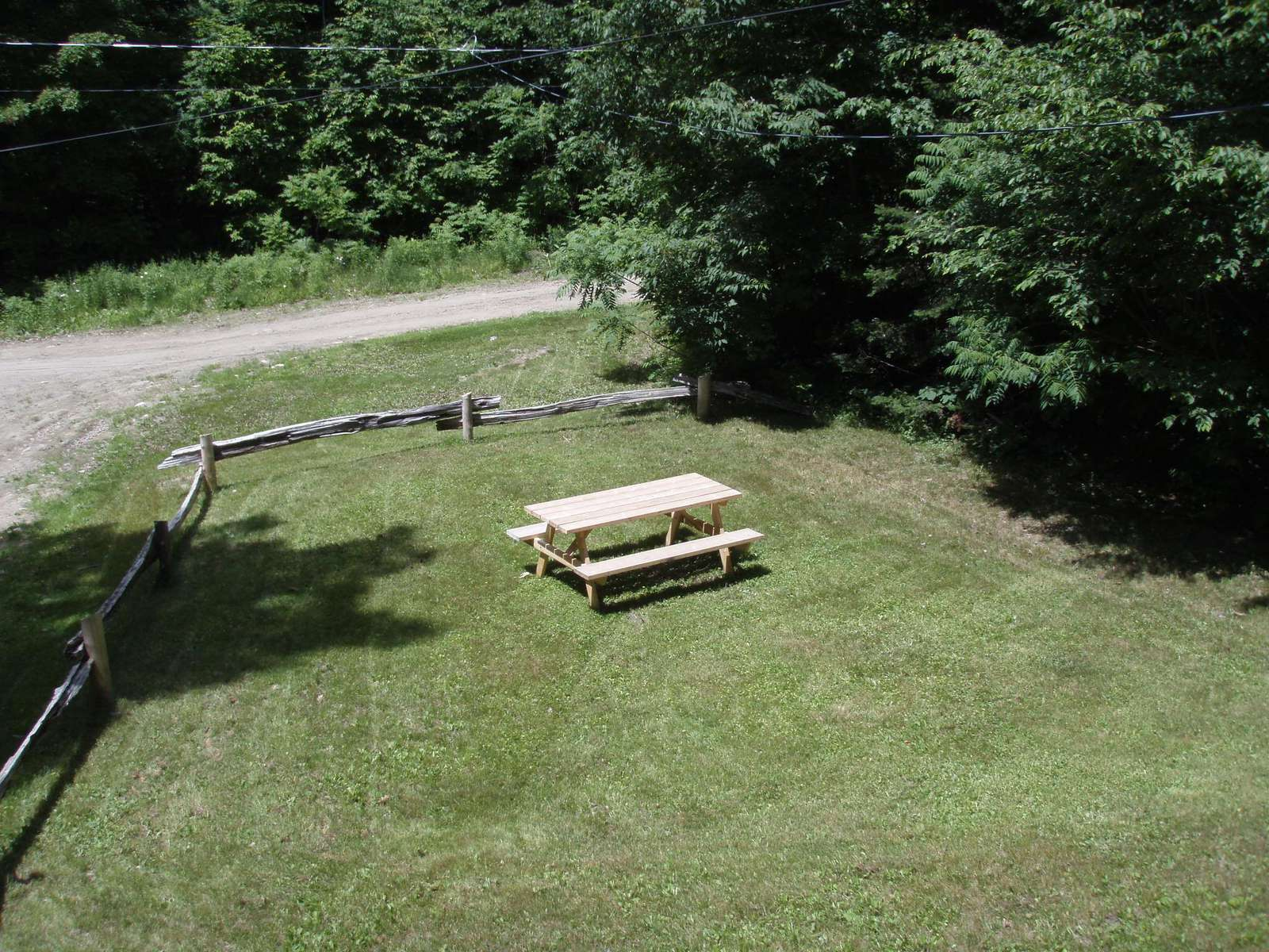 Picnic and play area. also, extra parking spaces on lower level of the grass (outside the fence)