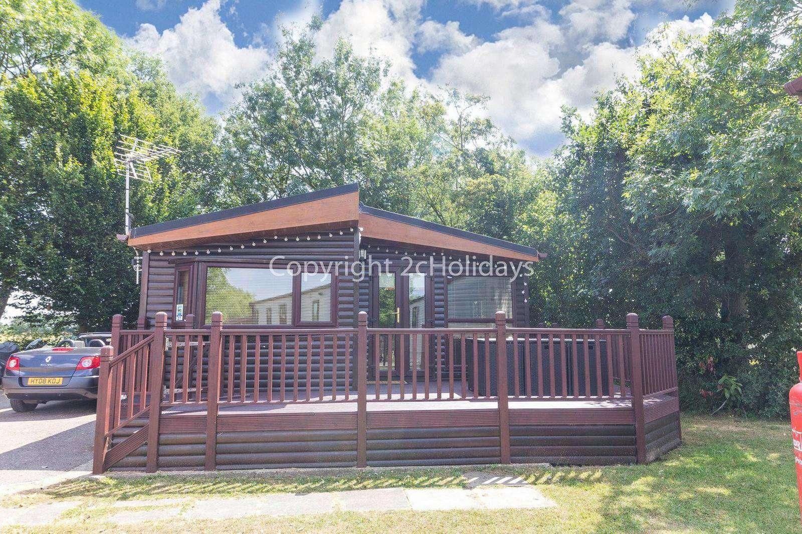 Decked accommodation at Carlton Meres Holiday Park