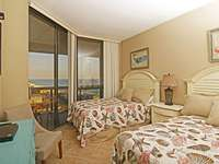 The second bedroom has balcony access and 2 queen sized beds. thumb