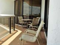 There is a large balcony that has beautiful views of the Gulf and opens onto the living room and both bedrooms. thumb
