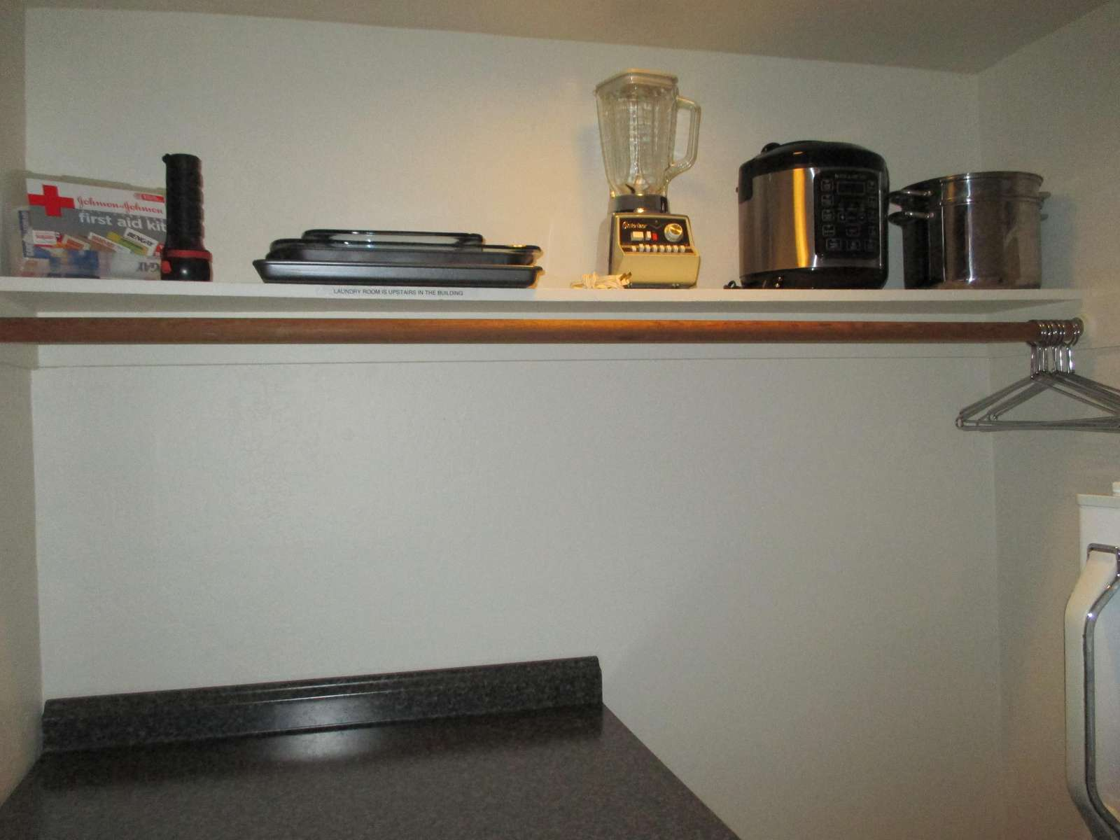 The walk in closet with additional kitchen amenities.