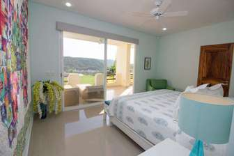 Master bedroom with king bed and step out to the loungers thumb