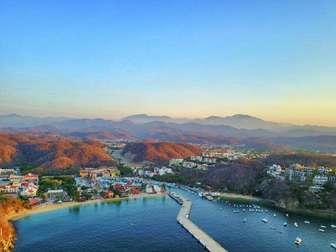 Aerial view of developement, santa cruz bay and marina thumb