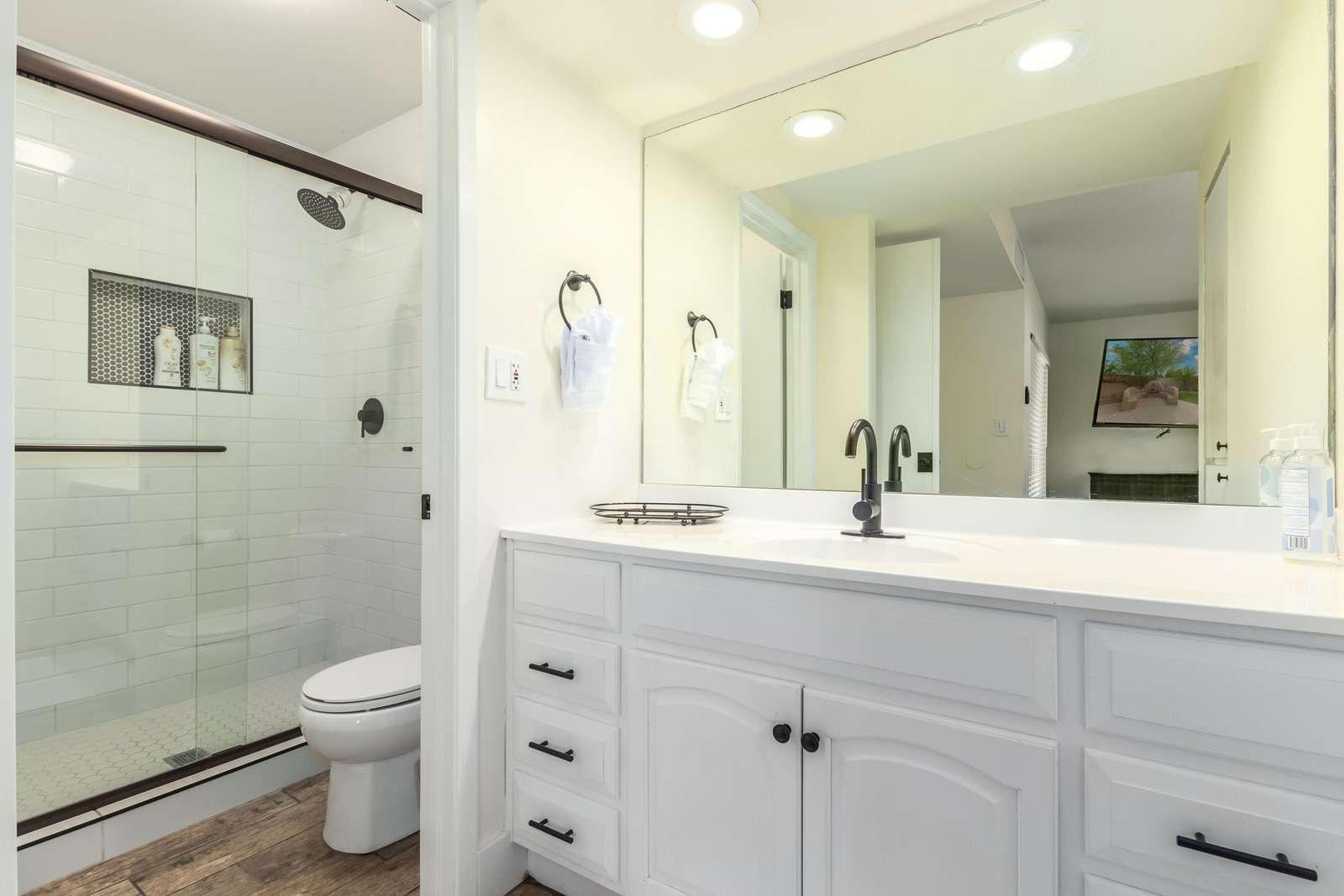 Primary bathroom with huge walk in shower.