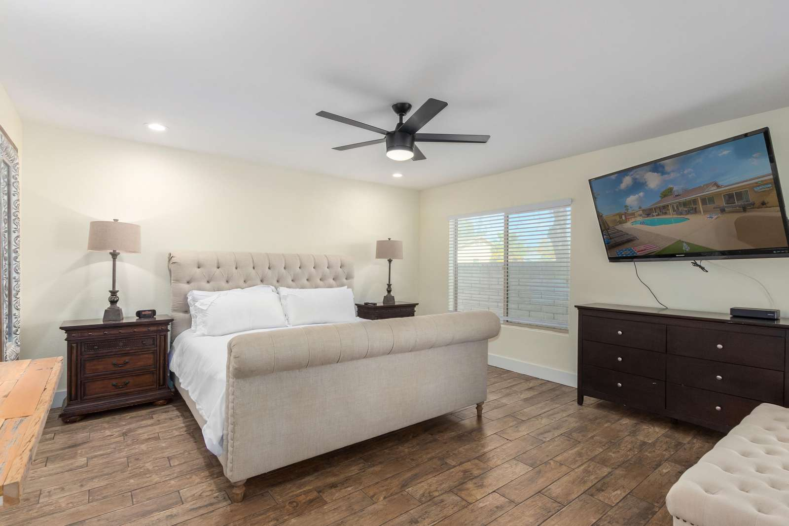 """Primary Bedroom - King Size Bed / 65"""" TV"""