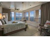 Another generous King Suite (Bdrm 4)...enjoy breakfast in bed while overlooking that Caribbean water! thumb