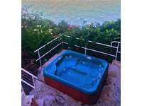 Private Large Jacuzzi to melt your cares away!  thumb