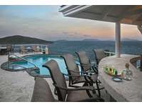 Wind down after a day of sun and fun at your own private pool bar!  thumb