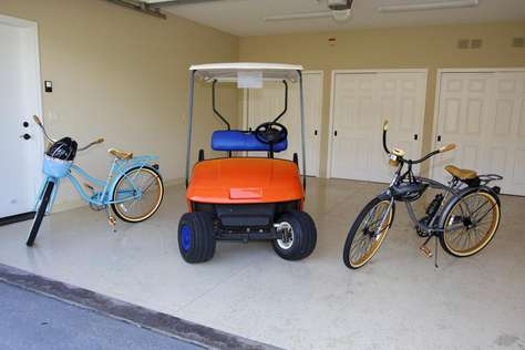 Home comes with amenities that include a golf cart, bikes and more