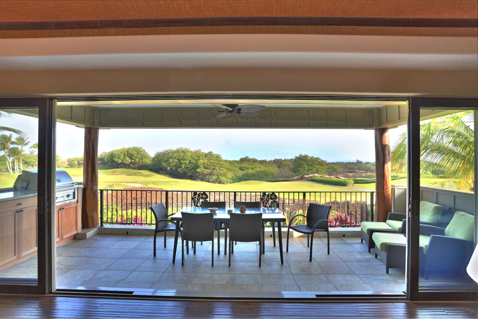 View out to the lanai, golf course and ocean