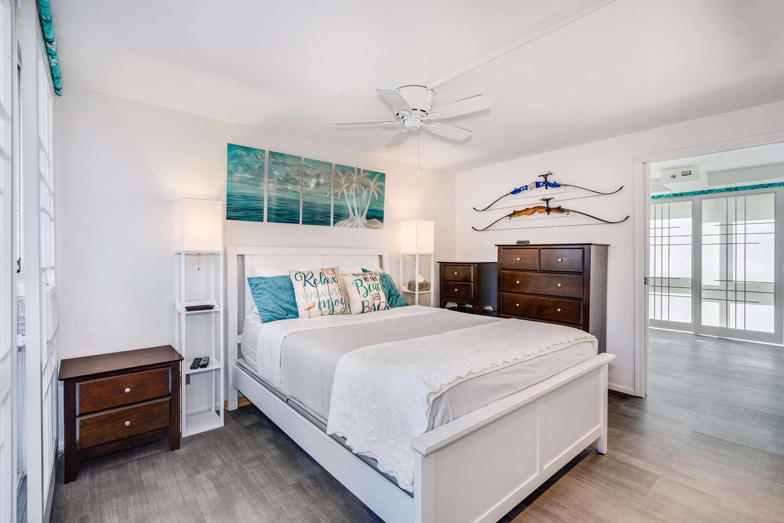Master bedroom with ample drawers and closet space.