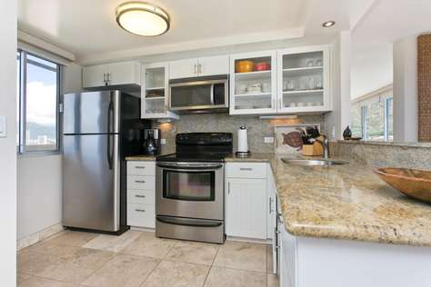 Modern Stainless appliances and all cooking utensils