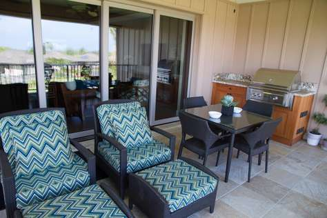 Lanai equipped with furniture, dining area and BBQ area.