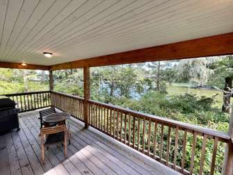 Large waterfront deck with BBQ thumb