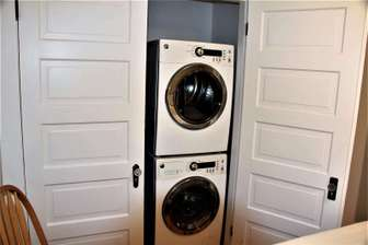 Front load clothes washer and dryer thumb