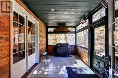 Screened Porch with Speakers and BBQ