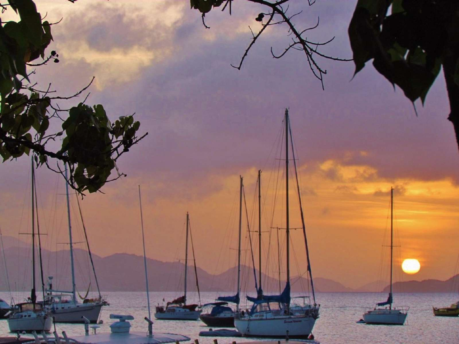 Travel to St. John and Enjoy a Sunset Over St. Thomas