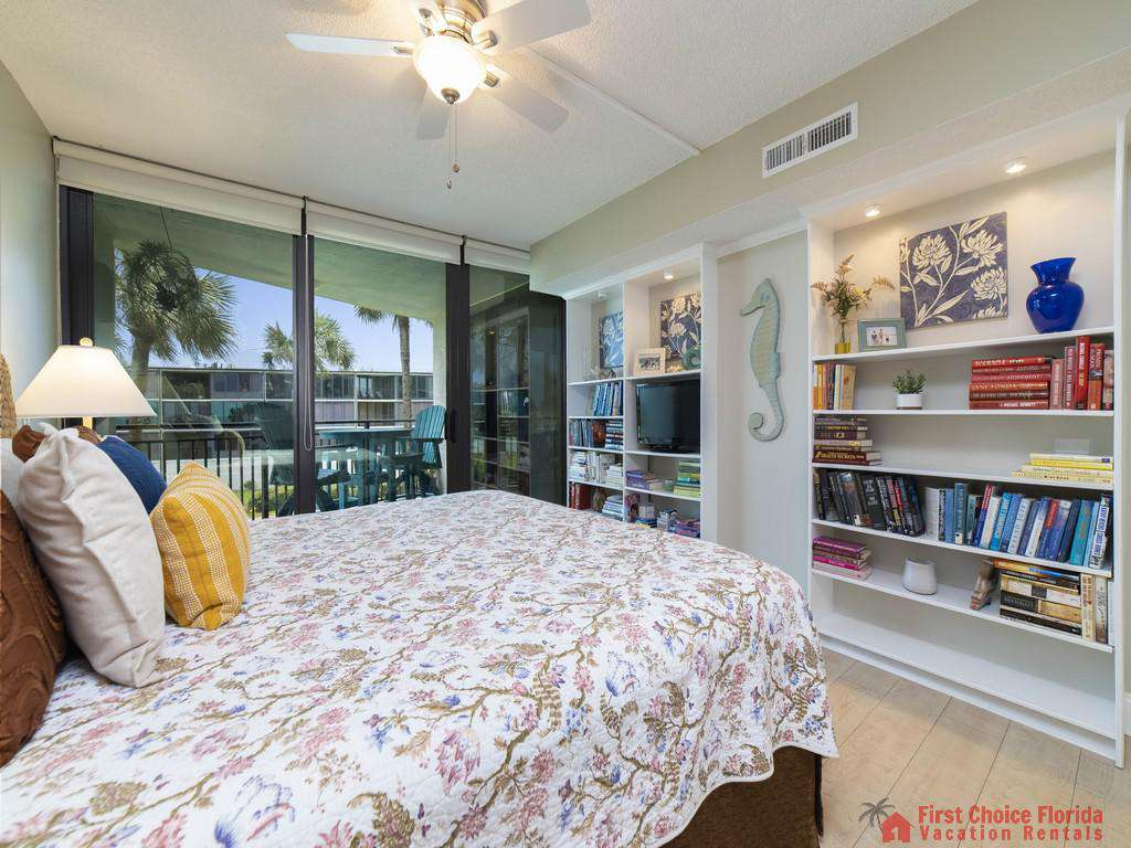 Anastasia Condo 303 Bed with TV and Shelves
