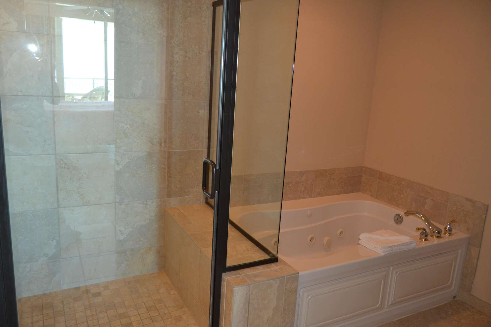 Stall shower, jetted tub