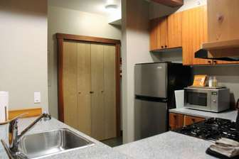 Kitchen with granite counter tops thumb