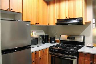 Full kitchen with gas cook top. thumb