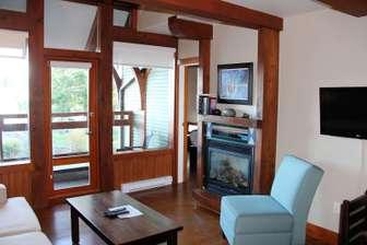 Living area with large Douglas Fir beams thumb