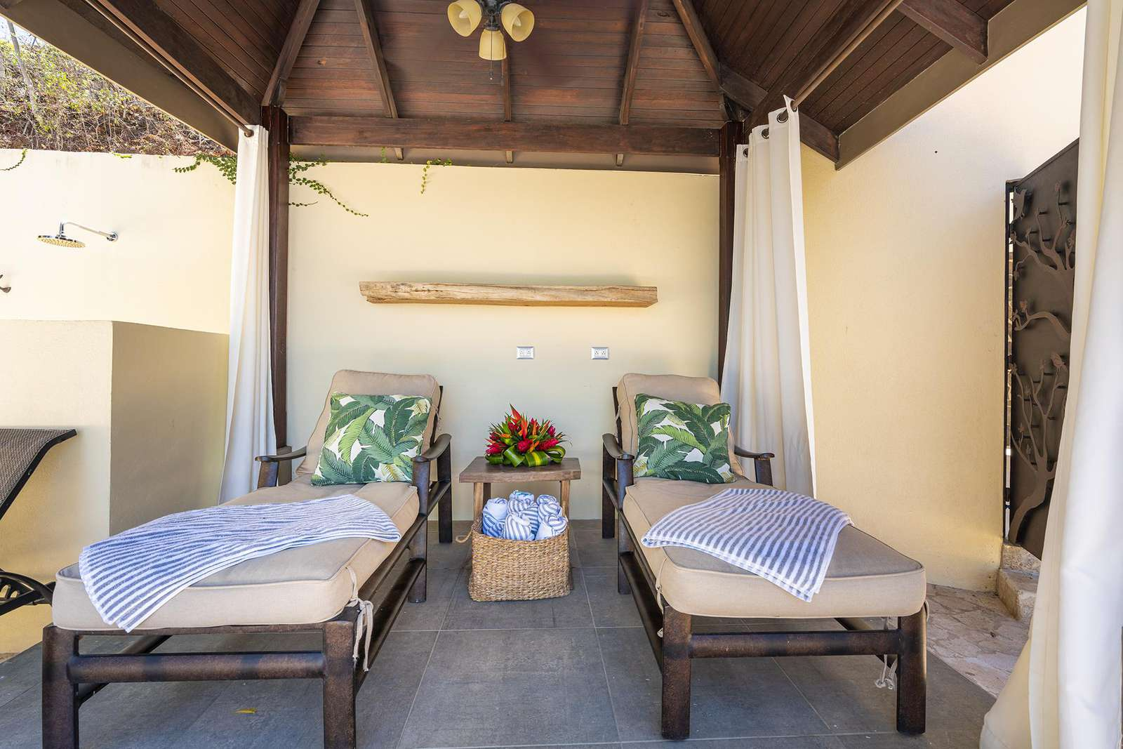 Cabana area with lounge chairs, poolside