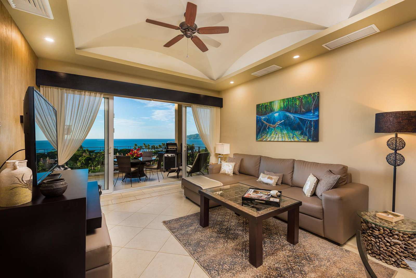 Spacious living room, seating areas and flat screen TV, ocean view