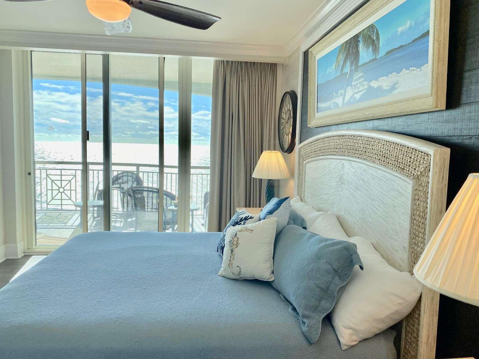 Oceanfront master bedroom, indirect lighting, balcony access,