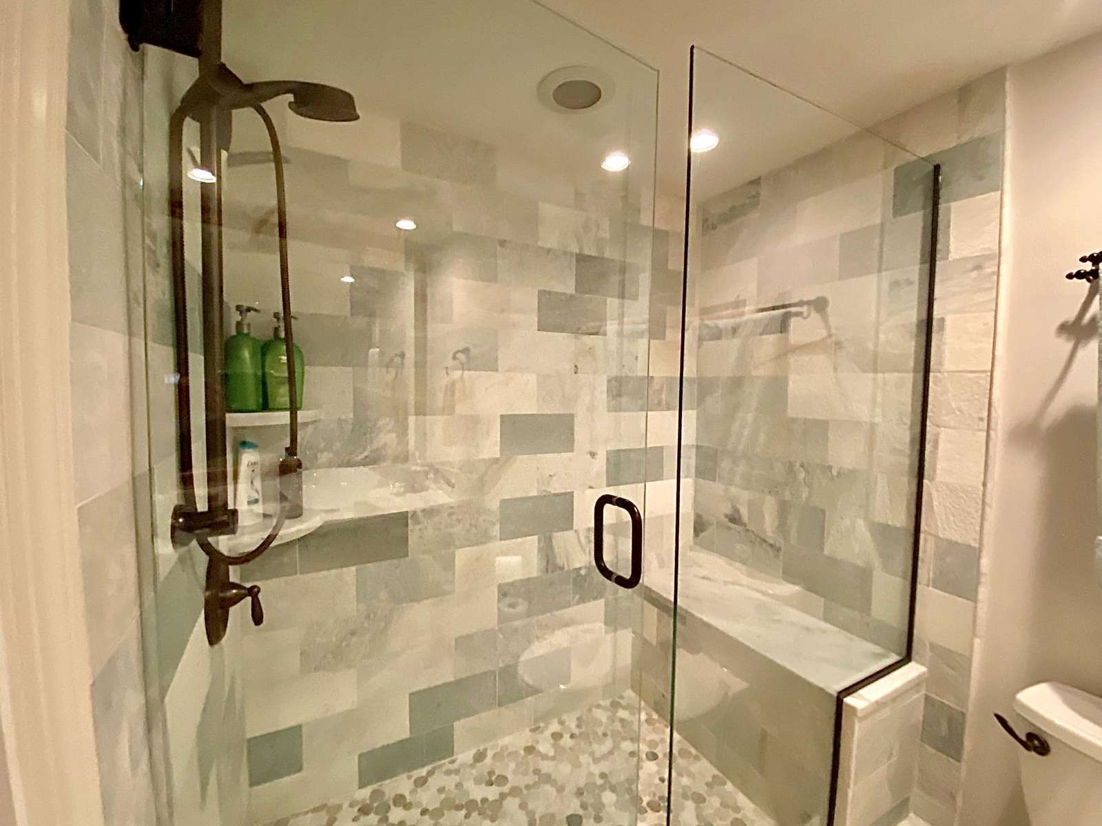Guest bath, custom tiled shower, custom countertop and sink