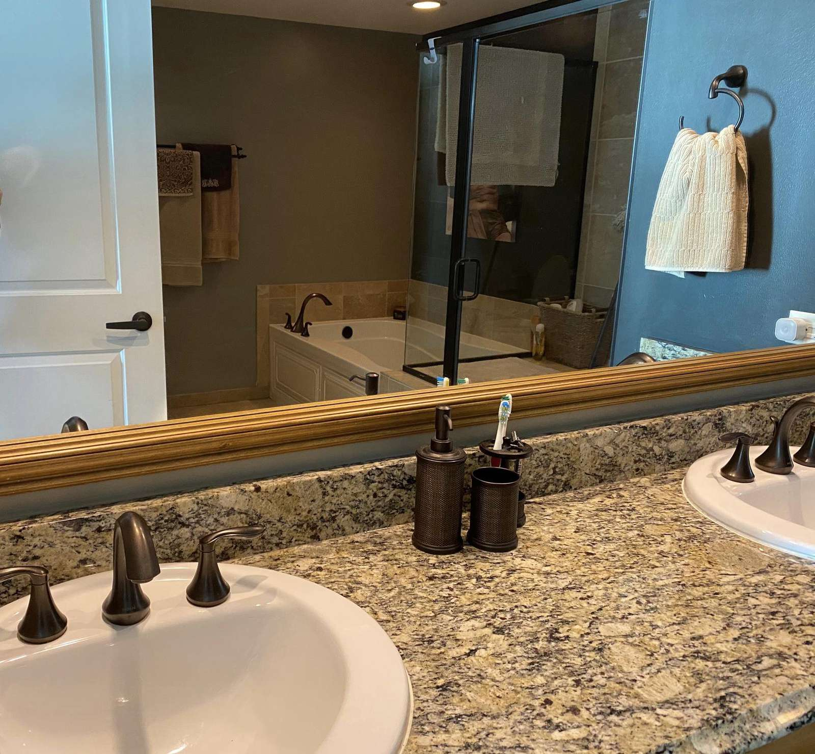 Master bath, double sinks, granite tops, separate stall shower