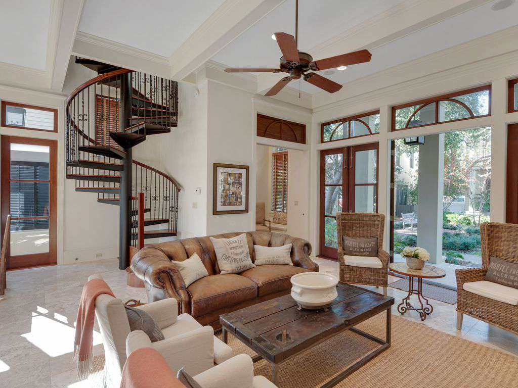 Family room flows onto front porch. Spiral stair case leading to second floor.