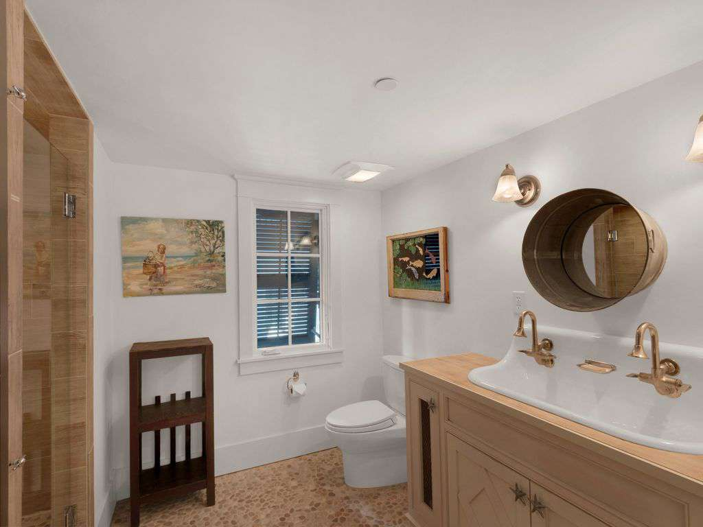 Adjoining bathroom to bunk area w/walking shower.