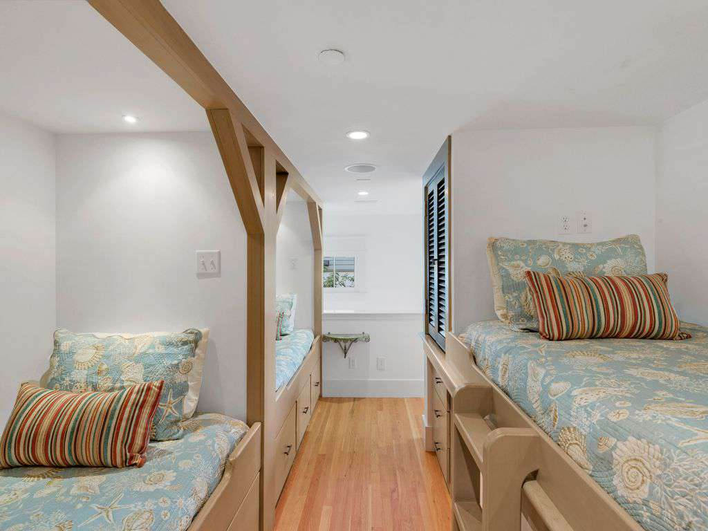 Bunk Area with Three beds connects to Bath w/ Shower. Separate stairway entrance