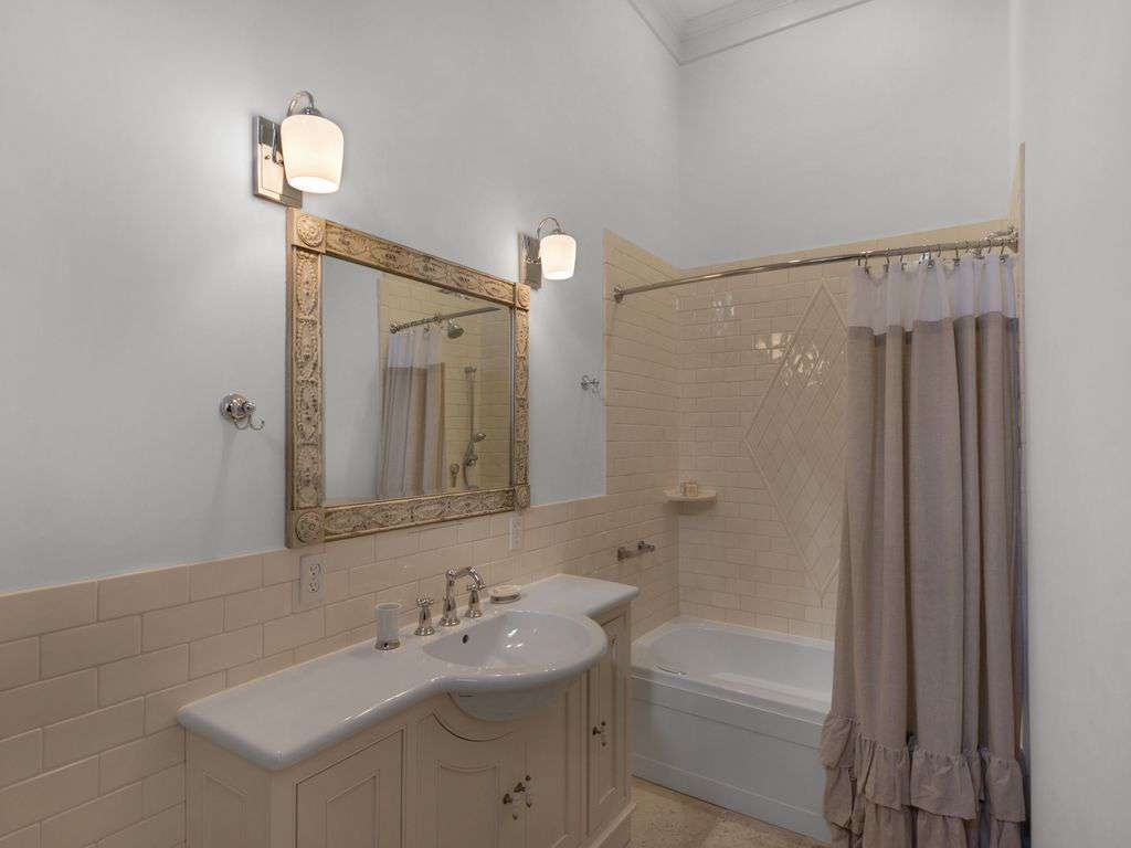 Adjoining bath to first floor master suite.