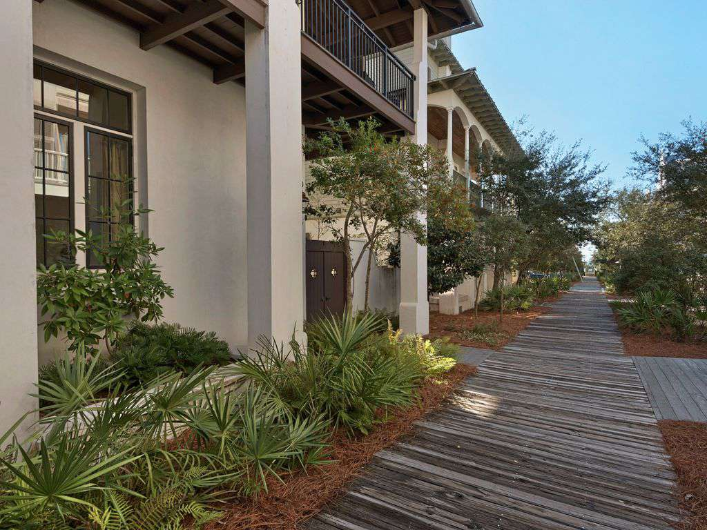 Walkway from front of home on boardwalk, steps to the beach.
