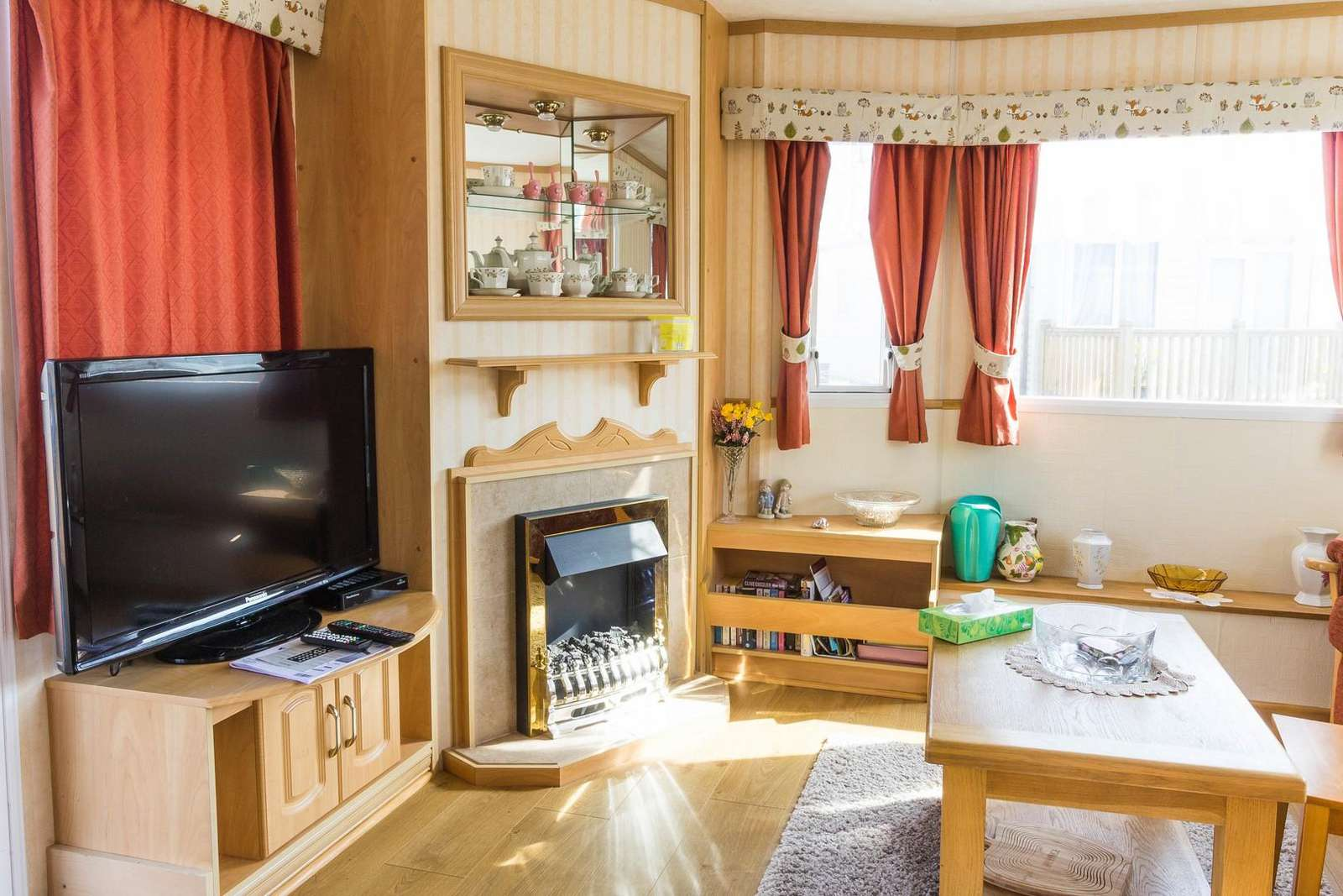 This lounge comes with a cosy electric fire and TV