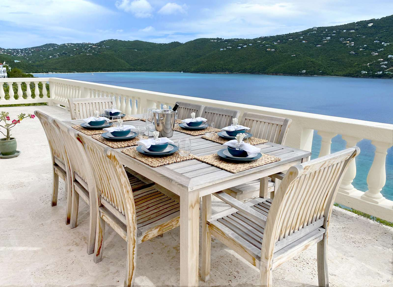 Al fresco dining set for eight on the upper terrace at Pallina with sweeping views of Magens Bay